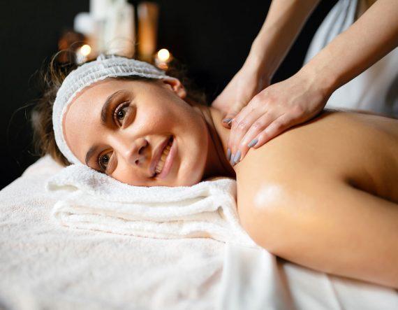 beautiful-young-and-cute-woman-enjoying-massage-UZ97GDC.jpg